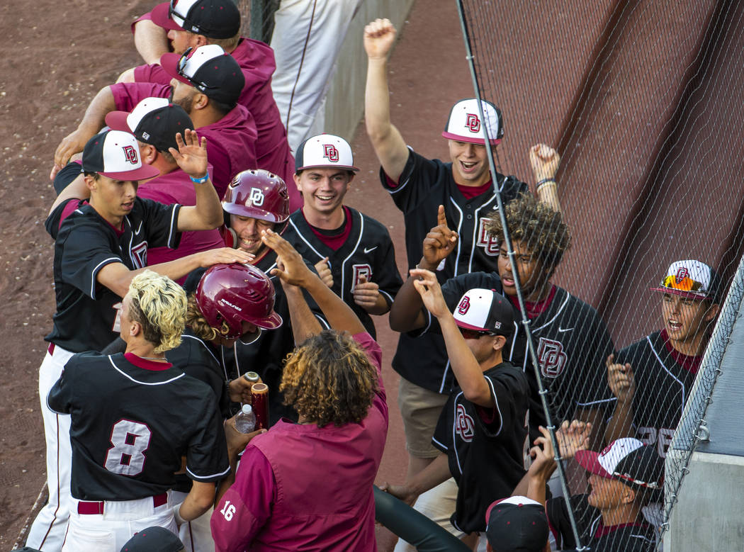 Desert Oasis players celebrate another run over Reno during their Class 4A state baseball tourn ...