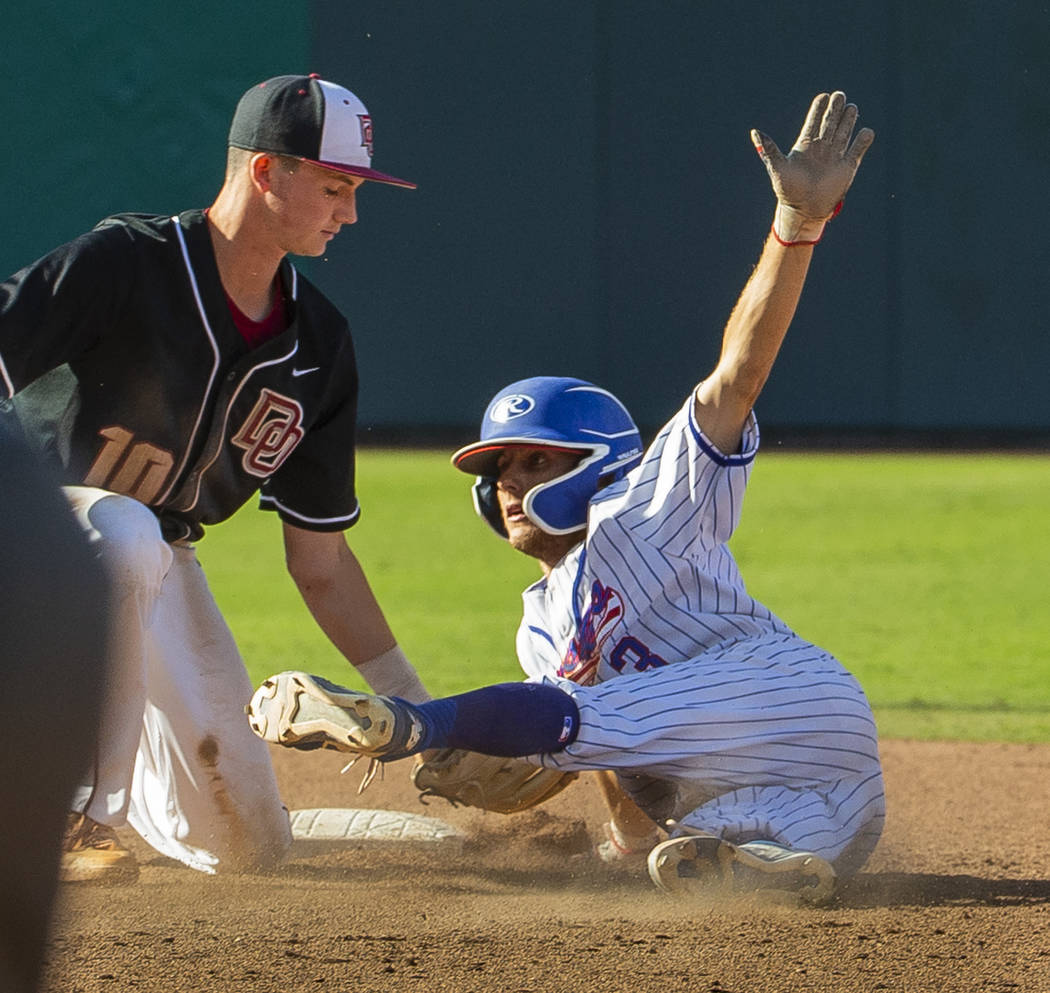 Desert Oasis Colby Smith (10) tags out Reno's Garrett Damico (3) at second base during their Cl ...