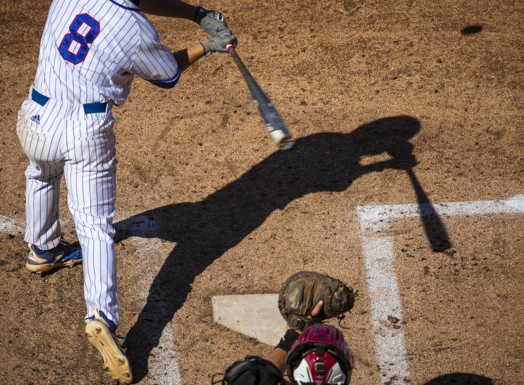 Reno batter Gunner Gouldsmith has his shadow cast on the infield as he faces a Desert Oasis pit ...