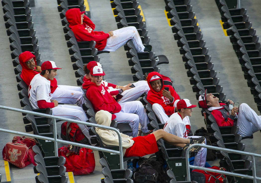 Arbor View players share some laughs in the stands before their game versus Las Vegas during th ...