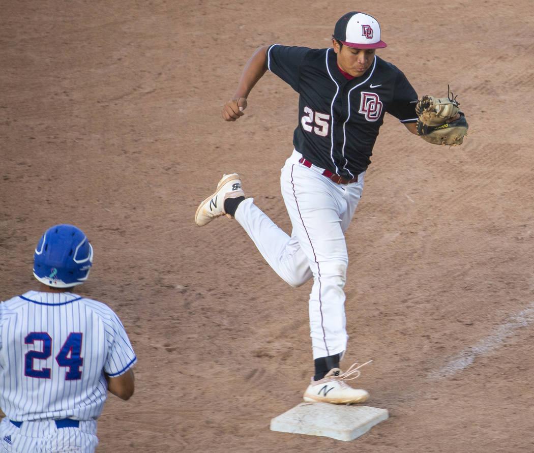 Desert Oasis' Aaron Roberts (25) makes the final out at first base over Reno's Skylar Hales (24 ...