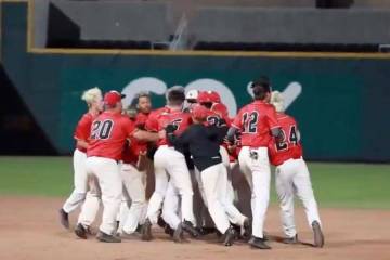 A screenshot from a YouTube video shows Las Vegas High baseball players celebrating their 5-4 w ...