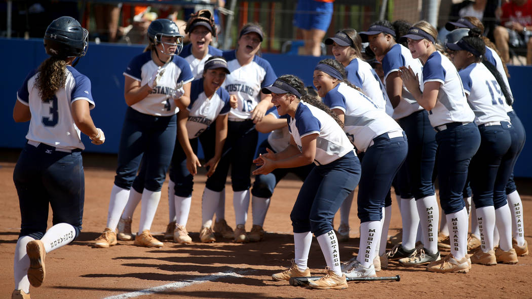 Shadow Ridge players celebrate a home run by Caitlyn Covington (3) in their Class 4A state cham ...