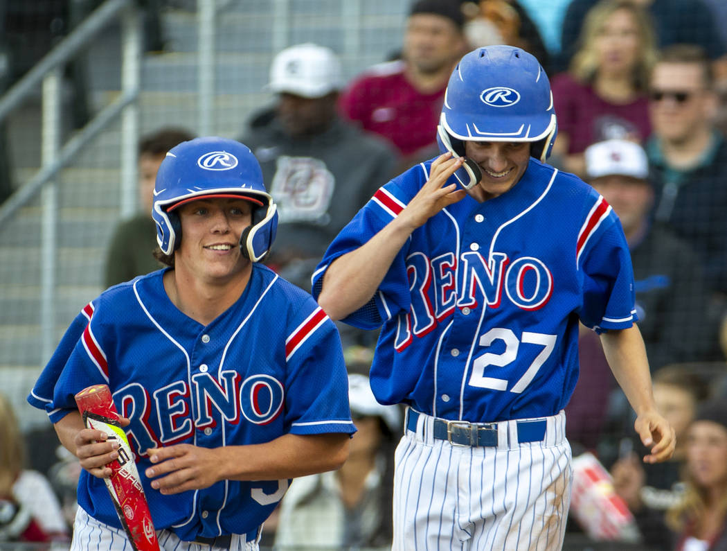 Reno's Drue Worthen (5) and Jake Novacek (27) look to their teammates as they celebrate their r ...