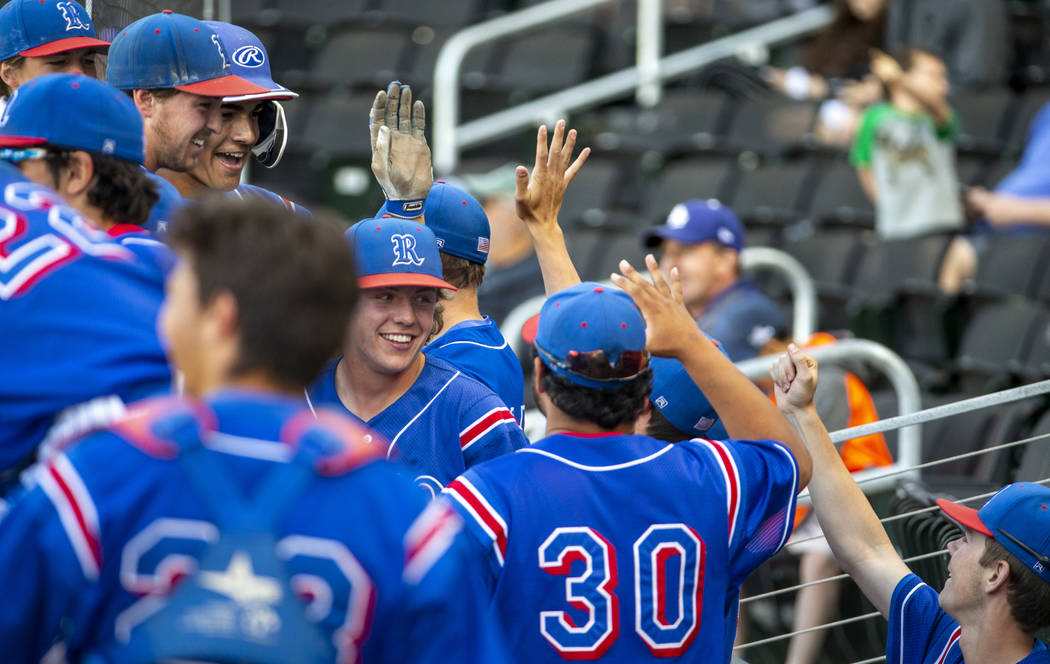 Reno players celebrate their game-winning runs in the sixth inning versus Desert Oasis during t ...