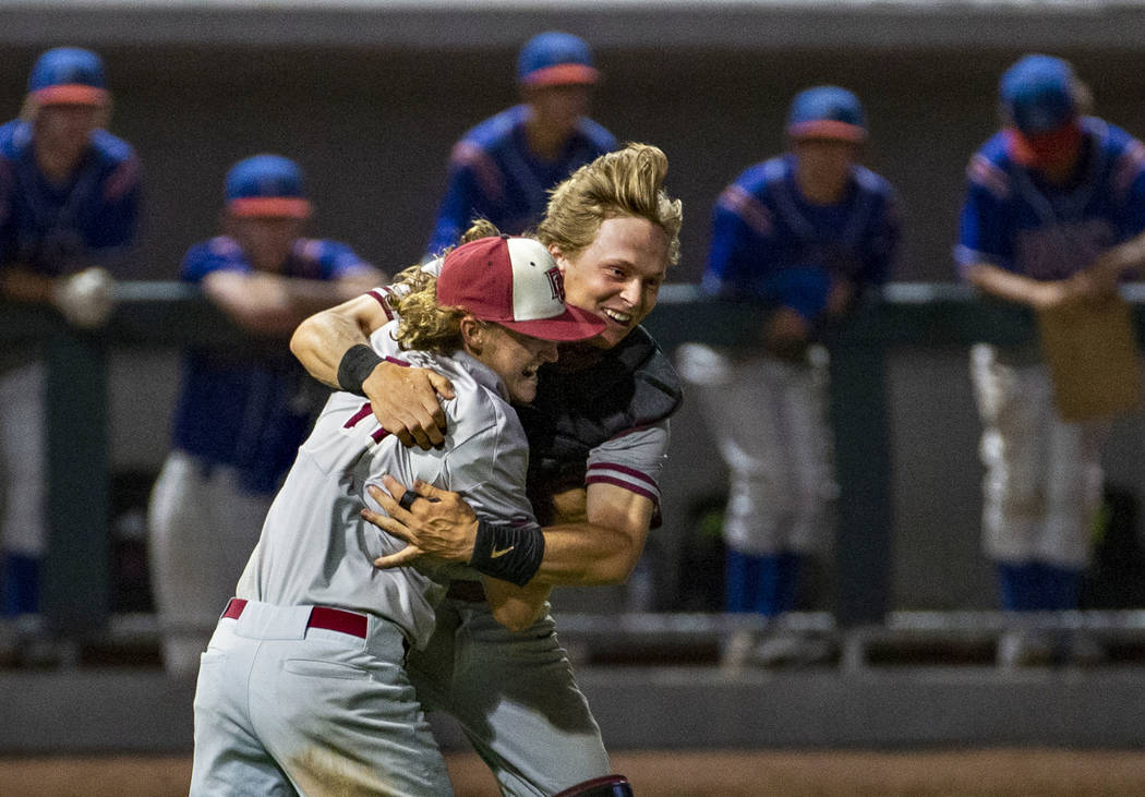 Desert Oasis pitcher Josh Sharman (11) celebrates their win with catcher Parker Schmidt (4) ove ...
