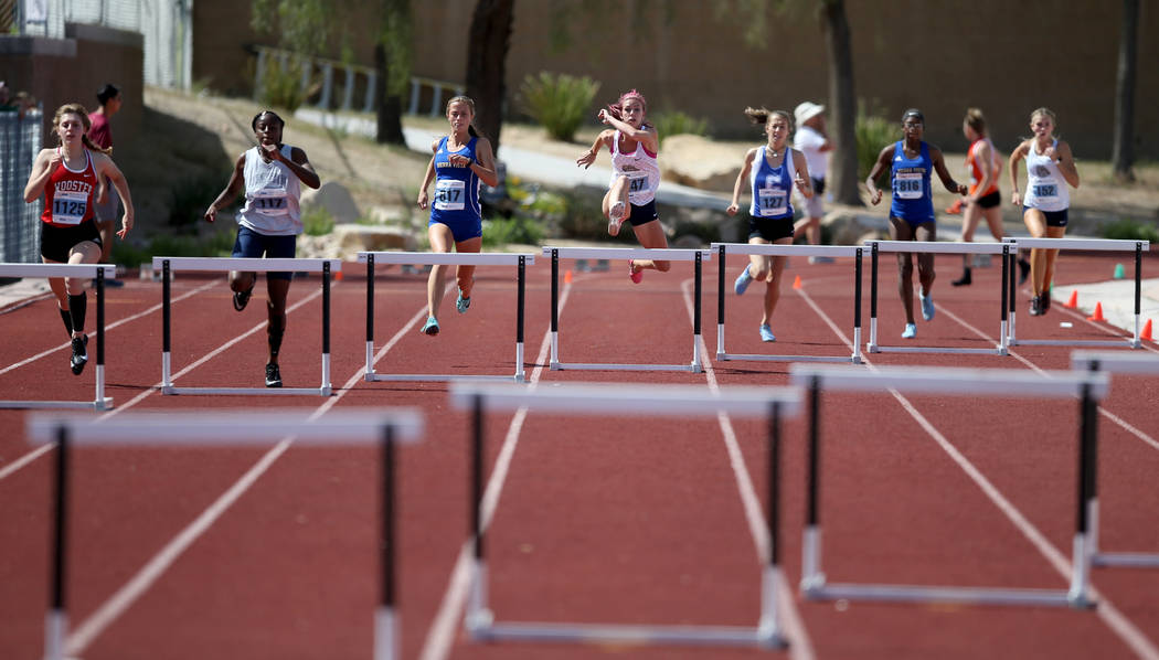 Quincy Bonds Centennial, center, on her way to winning Class 4A 300 meter hurdles in the state ...