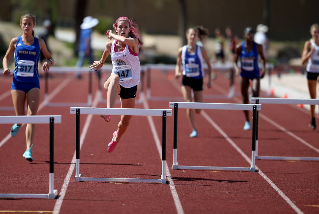 Quincy Bonds of Centennial, second from left, on her way to winning Class 4A 300 meter hurdles ...