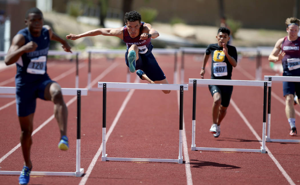 Justin Watterson of Coronado, second from left, on his way to winning Class 4A 300 meter hurdle ...