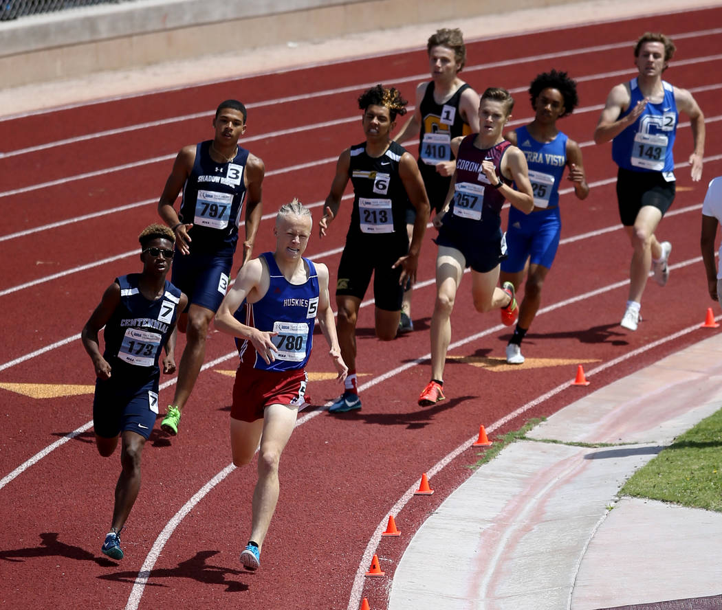 Noah Norris of Centennial, left, and Colby Thomas of Reno battle in the Class 4A 800 meters in ...