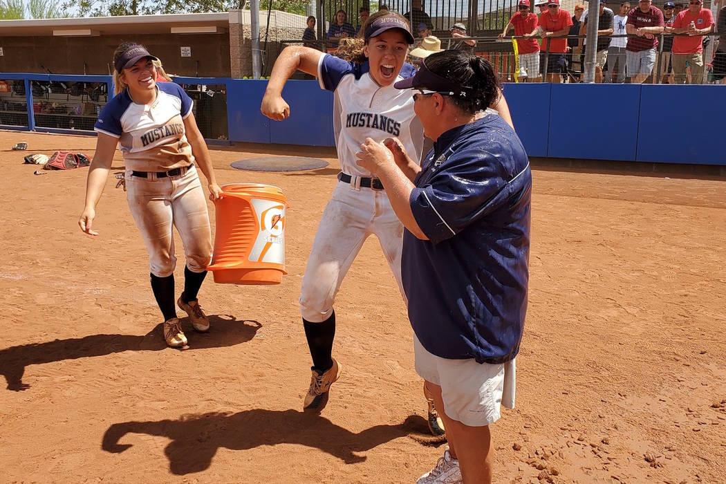 Shadow Ridge's Caitlin Covington (center) celebrates after dousing coach Julie Meyn (right) wit ...