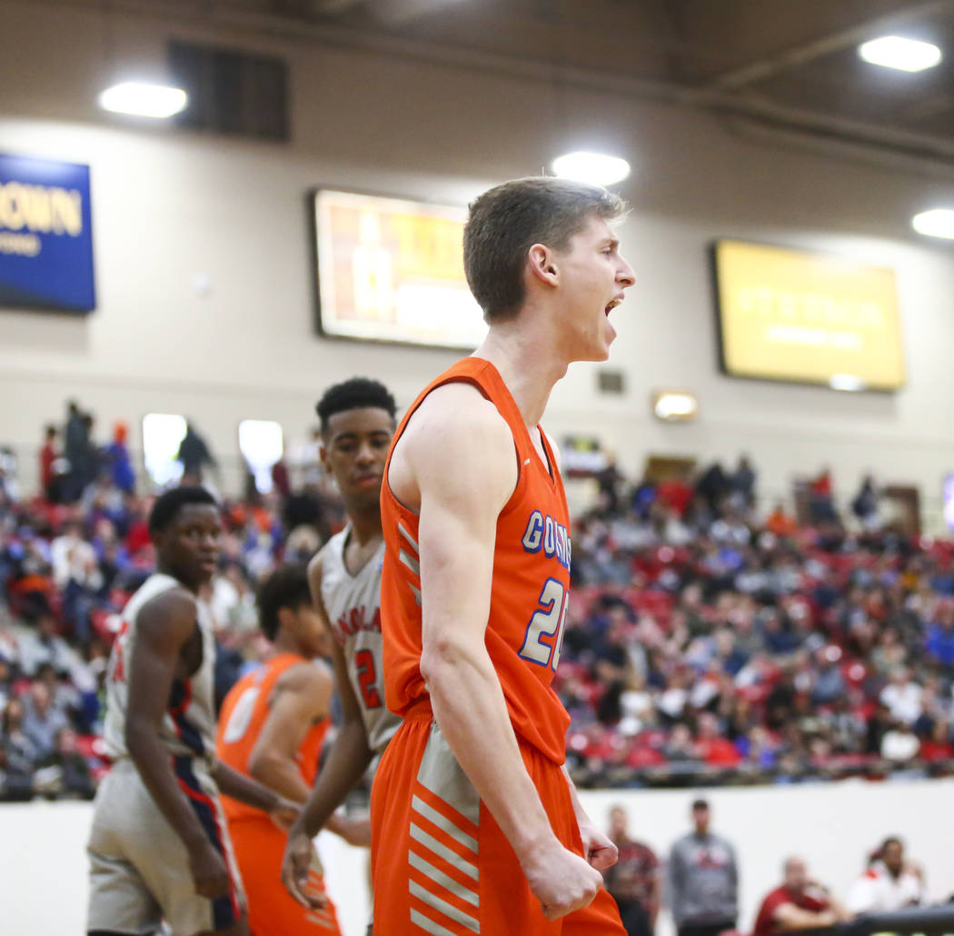 Bishop Gorman's Noah Taitz celebrates his dunk against Findlay Prep during the first half of th ...