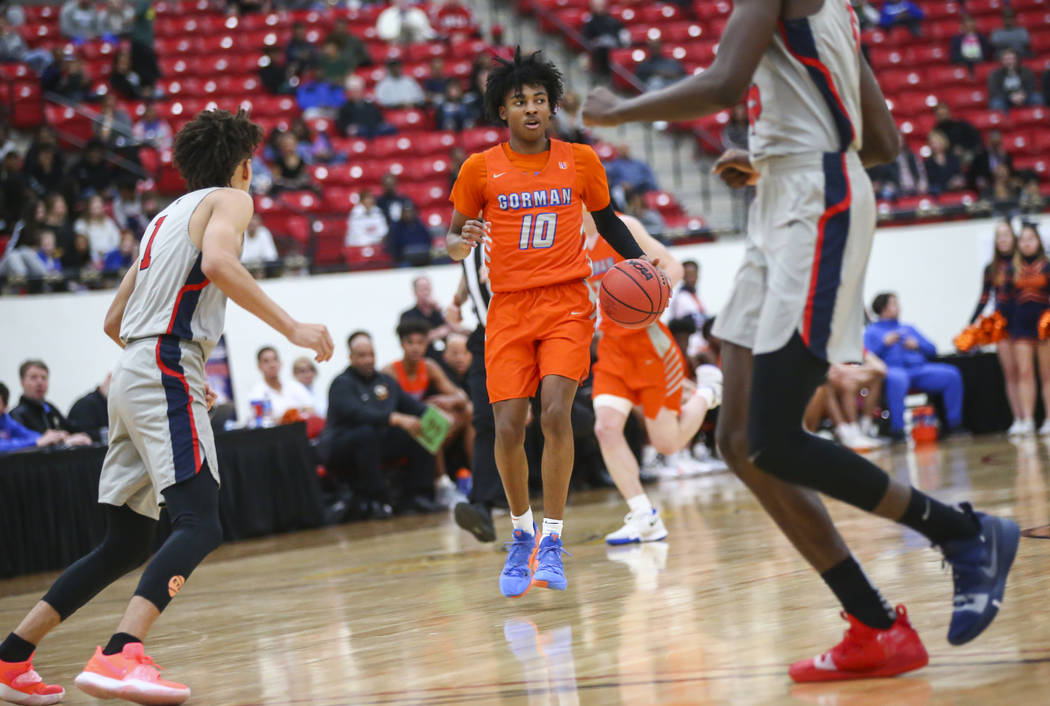 Bishop Gorman's Zaon Collins (10) brings the ball up court during the first half of the annual ...