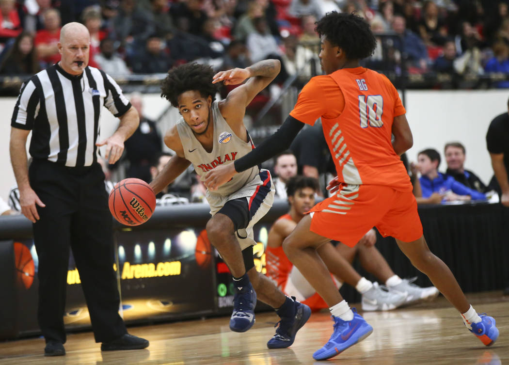 Findlay Prep's P.J. Fuller drives the ball against Bishop Gorman's Zaon Collins (10) during the ...