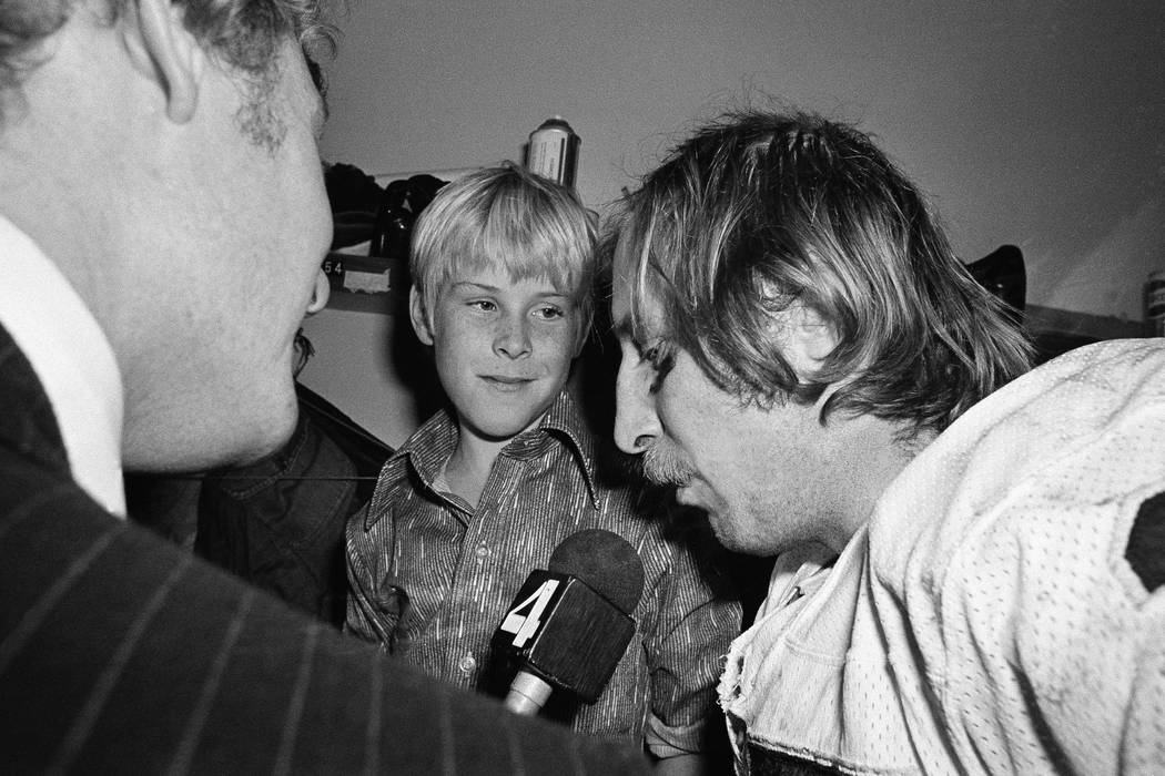 Ten-year-old Fred Biletnikoff Jr., center, looks in admiration at his father, one of the stars ...