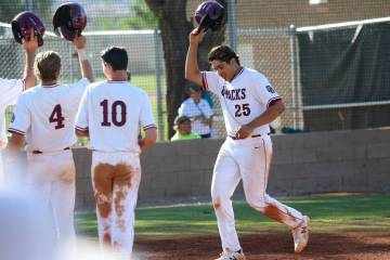 Desert Oasis' Aaron Roberts (25) runs home after hitting a three run homer against Basic in the ...