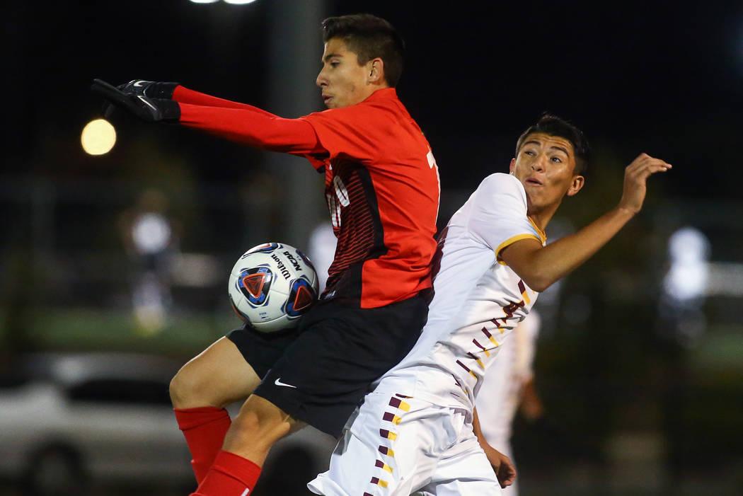 Coronado's Diaz Alfredo (13) traps the ball while under pressure from Eldorado's Alejandro Plaz ...