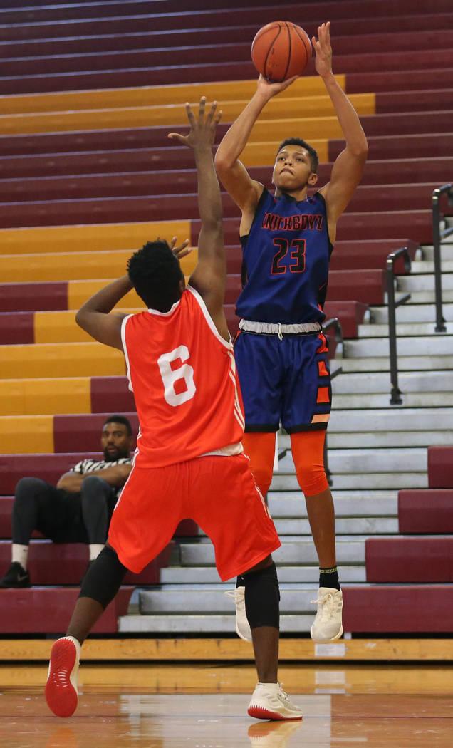 Las Vegas Knicks guard Nick Blake (23) takes a shot during his basketball game at Del Sol Acade ...