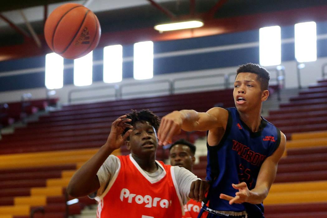Las Vegas Knicks guard Nick Blake (23) makes a pass during his basketball game at Del Sol Acade ...