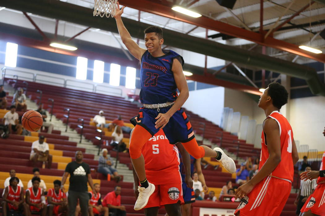Las Vegas Knicks guard Nick Blake is fouled (23) during his basketball game at Del Sol Academy ...