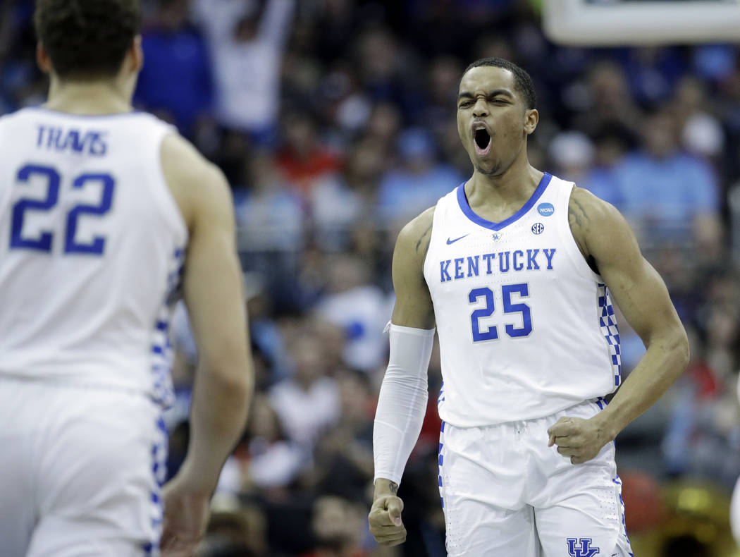 Kentucky's PJ Washington (25) celebrates with teammate Reid Travis (22) after scoring during th ...