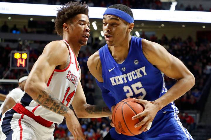 Kentucky forward PJ Washington (25) challenges Mississippi forward KJ Buffen (14) as he tries f ...