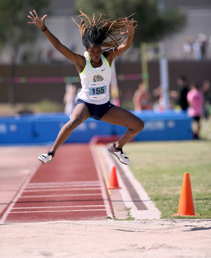 Ashley Moore of Centennial competes in the triple jump during the Class 4A state track meet at ...